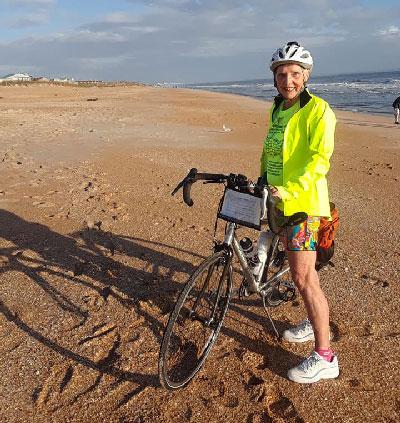 Carol Garsee with her bike on the Florida coast.