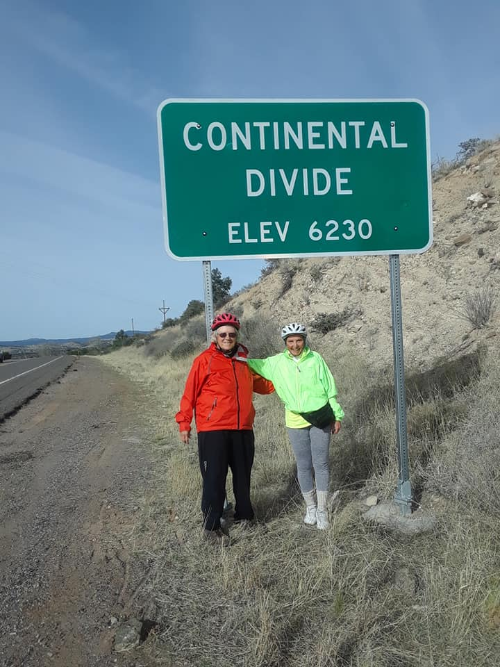 Carol and fellow cyclist Dot at the Continental Divide in western New Mexico, Elev 6230