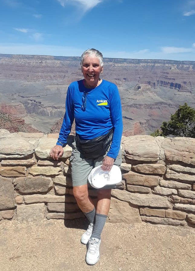 Carol standing at a lookout point on a Grand Canyon trail.